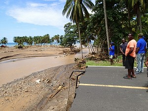 buildings destroyed, road washed away at Macoucherie, mid west coast of Dominica